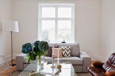 A calm white, blue and cognac Malmö home