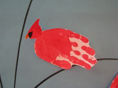 this is a handprint cardinal for my classroom's winter door.