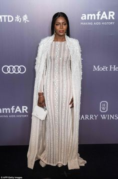 Sheer daring Naomi Campbell stunned in a semi-sheer white lacy gown as she arrived at the amfAR Hong Kong Gala on Saturday night