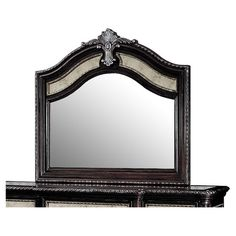 Bring elegant style to your master suite or guest room with this dark brown dresser mirror, showcasing a scrolling border and embellished arched top.
