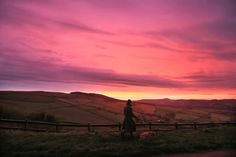 Week of Dec 6-12, 2014 A dog walker watches the sunrise near Buxton, England, on Tuesday morning as cold weather continues across the U.K. Lynne Cameron/Press Association/Zuma Press
