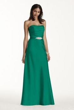 Timelessly chic, this stunning strapless long satin pleated bodice dress features a crystal belt, providing the perfect touch of glamour!  Pleated bodice provides flattering silhouette, accented at waist with crystal belt.  A-line skirt is universally figure flattering.  100% polyester.  Fully lined. Back zip. Dry clean only.  Available in Extra Length sizes as Style 4XLF17034.  To protect your dress, try our Non Woven Garment Bag.