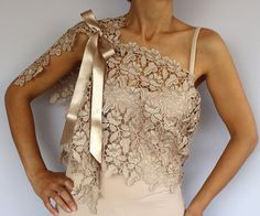This capelet is made of lace ecru beige color (also available in red colors)  Althought its rectangular shaped, my unique design, it can be used in different styles with asymmetrical looks, due to the placement of the satin ribbon lacings (1.2). You can create your own style with this complementary accessory having such a modern, minimal yet rich look.  It can be also a perfect bridesmaids gift!  Dim. 51.2 x 13.4 (130x34 cm).    Produced in pet and smoke-free medium.  Ready to ship!    You…