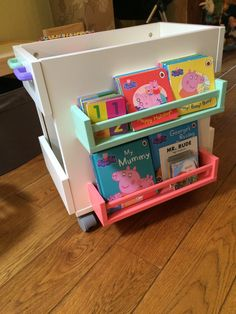 I made a Mobile Kids Book Storage out of an IKEA bedside cabinet and some BEKVAM spice racks. The racks are perfect for little books and the larger ones.