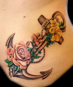 Anchor with flower side tattoo
