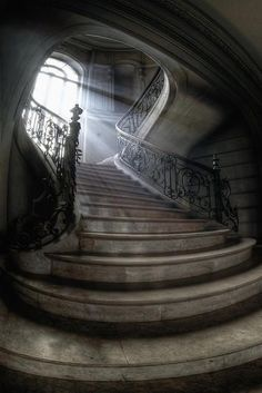 there is a stairway that leads to the floor where the music is playing behind a locked door