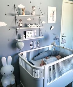 Really cool modern baby boy room idea. This baby crib looks nice. I think the large bunny is a night light, I love it!