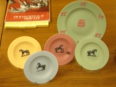 Late 20th century reproductions of George Stubbs's horse designs on Wedgwood jasper plates.