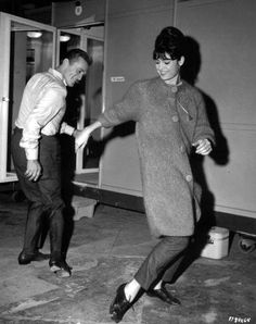 """LET'S DANCE: Kirk Douglas and Rosanna Schiaffino do the twist behind the scenes of """"Two Weeks in Another Town."""""""