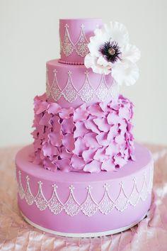 purple petal wedding cake - photo by Bronwyn Duffield Photography http://ruffledblog.com/candy-colored-wedding-inspiration-in-charlotte #weddingcake #cakes