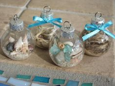 Easy DIY Glass Ball Beach Ornament for a beach themed tree or Christmas decor. This is perfect for weddings kids Christmas ornaments for an apartment a friends gift teachers gift and craft. Seashell Christmas Ornaments, Coastal Christmas Decor, Beach Ornaments, Nautical Christmas, Ornament Crafts, Christmas Crafts, Christmas Decorations, Kids Christmas, Diy Ornaments