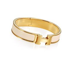 "Clic H Hermes narrow bracelet Cream enamel<br />Gold plated hardware, 2.5"" diameter, 8"" circumference, 0.5"" wide<br />"