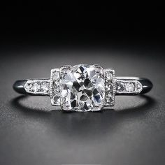 like this setting with the diamond flanked by the two smaller rectangles and some sparly on the band too.