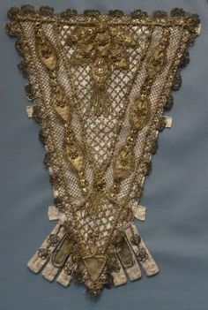 Stomacher, France, 1700-1750. Silk satin with metallic-thread lace, appliqués, passementerie and tassels.