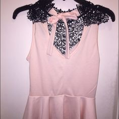 Pink and lace peplum Pink peplum top with lace like back and tie. Cute and dressy. Never worn. Nwot Tops Blouses