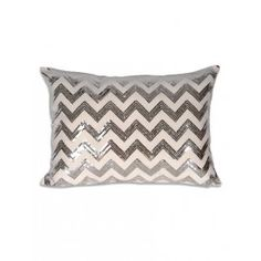 """$39.00.Bring on the chevron. This sequined chevron pillow will dazzle any room. Pair it with the Meadow Pillow to create the perfect combination of style and grace. The shine of the sequins brings excitement and spunk to beds, chairs, and sofas alike. Zigzag meets major swag.16"""" x 22""""Feather FillZipper closureSpot clean only"""