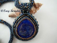 Embroidery Necklace.A beautifull cabochon in drop shape from lapis lazuli beaded with toho and miyuki seedbeads and hexcut.The necklace is made in RAW