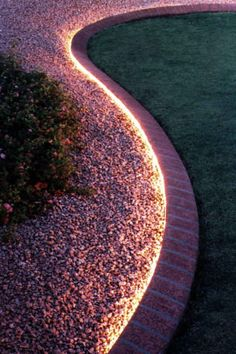 Dramatic look for a simple backyard landscape. rope lighting in the edge paver
