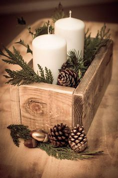 Build the little box out of scrape wood. Stick some pine cones, greenery, & candles inside.