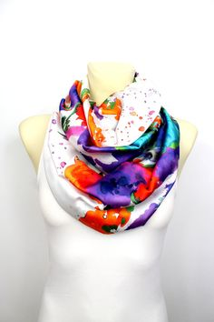 Rainbow Floral Infinity Scarf made of Italian satin silk perfect to use as a women fashion accessory during Fall or to give it as a Christmas gift. Handmade by Locotrends and available on Etsy. On request it can be made as an infinity scarf or open ended.