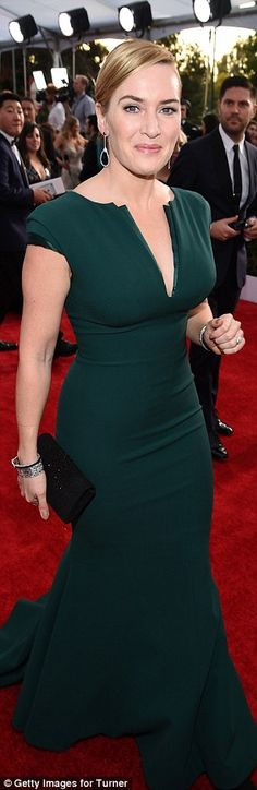 Classic beauty: Kate stayed true to her classic sense of style in a dark green fishtail go...