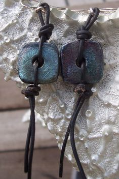 Raku pottery and leather earrings by lucia