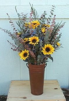 Dried eucalyptus arrangement with sunflowers