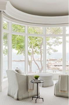 such a pretty yet peaceful sitting area overlooking the water.