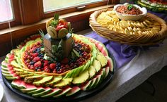 These look tasty & fun.  In-season fruit/veggie displays & some kind of dip with bread in the background.