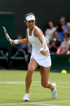 Ana Ivanovic Photos Photos - Ana Ivanovic of Serbia reacts during her Ladies' Singles third round match against Julia Goerges of Germany on day six of the Wimbledon Lawn Tennis Championships at the All England Lawn Tennis and Croquet Club at Wimbledon on June 30, 2012 in London, England. - The Championships - Wimbledon 2012: Day Six