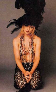 Feather hat topless Madonna yup