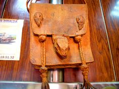 North African bag with lizard head and paws.