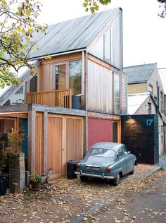 Marcus Lee and Rachel Hart's wonderful wooden home sits at the end of a quiet London lane and politely turns its back on the workshops next door. Photo by Jeremy Murch. Read more: http://www.dwell.com/articles/slanted-and-enchanted.html