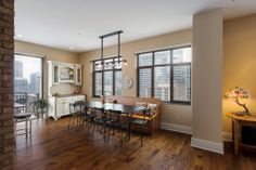 Chicago #penthouse loft dining area design is simple and chic.