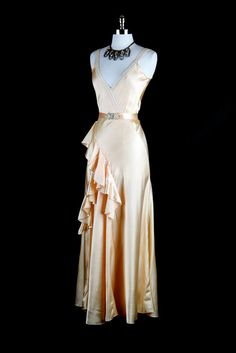 "Madeleine Vionnet was the person who created the Bias cut. I think this dress was inspired by the Greek. ""Pale pink 1930s bias cut gown with ruffles"""