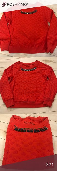 Jessica Simpson girls orange sweater! Bright orange/red sweater with detailed hearts on the fabric! Neck line has sparkly jewels that add a touch of sparkle! Good condition, size L. Jessica Simpson Shirts & Tops Sweaters