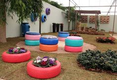 recycled-tires-garden-ideas-stool-flower-bed-wall-decor-colourful