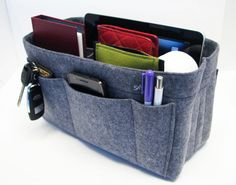 M1. Grey felt bag organizer - medium size (W 11in H 6.3in D 4in ), also for a school / baby bag, desk, car & etc.. $32.75, via Etsy.  via samorga shop owner