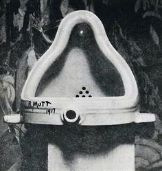 The original Fountain by Marcel Duchamp photographed by Alfred Stieglitz at the 291 (Art Gallery) after the 1917 Society of Independent Artists exhibit. Stieglitz used a backdrop of The Warriors by Marsden Hartley to photograph the urinal. The entry tag be clearly seen. (via Wikipedia)
