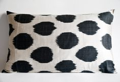 It has,  :: ts made of ikat silk  :: The cover is zipped on the down  :: This listing is for pillow cover only without insert/filler.  :: 15x24 - 39x60 cm