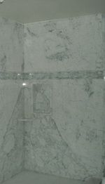 Solid sheet of marble for shower. No more grout scrubbing.
