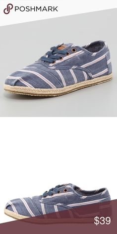 """TOMS striped canvas cordones Preowned, TOMS canvas Cordones in navy. Size 10. Revamping the original slip-on with oxford details, this version of the Cordones features cheery striped canvas and casual jute midsole. Striped washed canvas (hemp/cotton/recycled polyester). Topstitching caps toe and outlines lace-up vamp. May be worn with or without laces. Pleated square toe. Leather logo patch on tongue. TOMS logo flag at heel. 1/2"""" jute midsole. Canvas lining; padded insole. Hemp-covered…"""