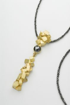 Tumbling necklace in 18 carat gold with rose cut black diamond and black diamond beads by Daphne Krinos