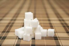 Frozen Party - Sugar Cube Stacking Game - How tall of a tower can you make?  Increase the difficulty by using chopsticks instead of your fingers.