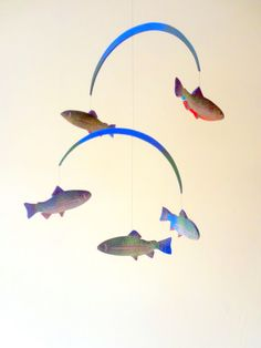 Fish Mobile, five colorful hand painted wooden trout swimming in a circle.. $90.00, via Etsy.