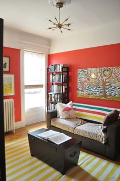 Love this wall color. I pretty much already have the rug too. Maybe for a cheery office. Link suggests a similar color might be Benjamin Moore's Blazing Orange.