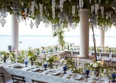 I will never forget walking into the reception. Fiona created something that was more beautiful than I had ever imagined. The hanging lanterns and canopy of wisteria were unbelievable. There were hand-painted Sicilian Moor heads with passionflowers, clematis, and peonies winding down the table.