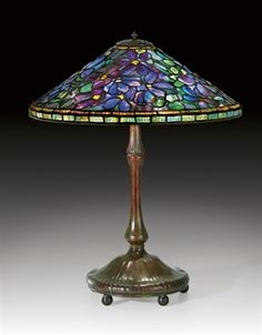 TIFFANY STUDIOS  A 'CLEMATIS' LEADED GLASS AND BRONZE TABLE LAMP, CIRCA 1910