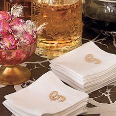 Upgrade Linens with No-Fuss Flourishes | Use iron-on monograms to instantly and inexpensively personalize simple white cocktail napkins at the bar.