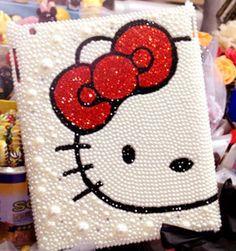 Faux pearls and swarovski crystals Hello Kitty Ipad Cover case. €35,00, via Etsy.